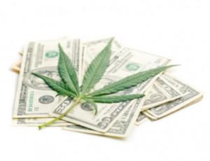 Pile of money with marijuana leaf: Smokedistrict Cannabis Blog